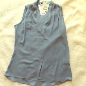 Light blue sleeveless blouse